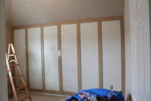 Vertical boards on paneled wall