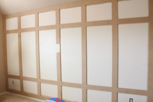 Boxes on paneled wall