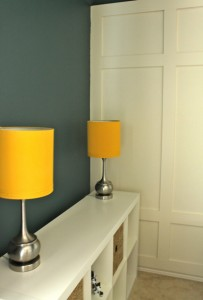 Yellow Lamps and Paneled Wall