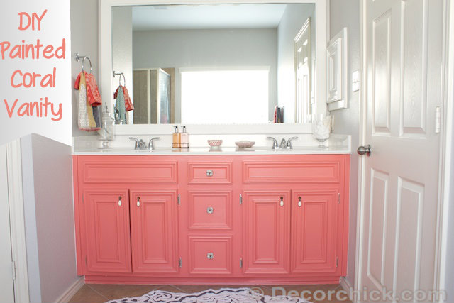 Coral Reef by Sherwin Williams - coral vanity with gray walls