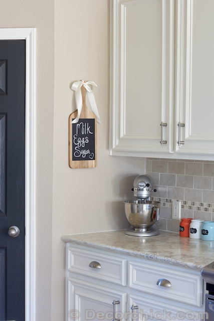 White Kitchen Cabinets and Charcoal Door | www.decorchick.com